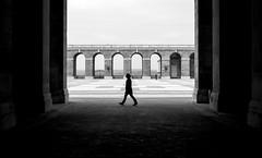 Street arches (fernando_gm) Tags: madrid street people blackandwhite bw blancoynegro monochrome contrast 35mm person monocromo spain fuji symmetry simplicity fujifilm simple simetria