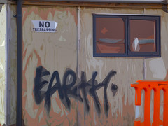 Earth - No Trespassing (Steve Taylor (Photography)) Tags: wood city newzealand christchurch orange brown abstract black art window glass digital graffiti earth canterbury plastic nz southisland barrier cbd notrespassing woodchip