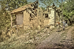 About Things That Pass (Alfred Grupstra Photography) Tags: houses woman ruins path stones donkey mk ohr macedonivjrm