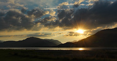 Onich sunset (yorkiemimi) Tags: sunset sea sky sun mountains nature water dark landscape evening scotland scenery onich