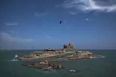 Vivekananda Rock Memorial (Ravikanth K) Tags: blue sea india kite green bird beach monument water rock ferry clouds landscape island boat fly memorial eagle flight historic southern tip cape meditation swami tamilnadu kanyakumari vivekananda comorin 500px