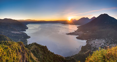 "Reality leaves a lot to the imagination."" (traumlichtfabrik) Tags: morning travel sky panorama mountain lake nature water horizontal sunrise landscape lago outdoors volcano pentax outdoor guatemala pano sigma nopeople atitlan journey serene viewpoint hdr centralamerica k5 lakeatitlan lagodeatitlan 2016 photomatix autopanopro sigma1770 indiannose"