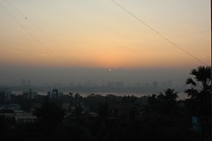 sunrise over Bombay, 2 of 3 (olive witch) Tags: trees light sun india skyline sunrise outdoors december day horizon bombay mumbai bandra dec15 2015 abeerhoque