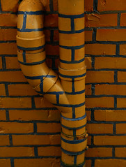 Camouflage (Samantha Evans of Samantha Evans Photography) Tags: building brick geometric lines canon ga georgia whimsy paint pattern arch architecturaldetail bricks humor pipes pipe canton smalltown brickwork rectangles repeatingpattern canon24105 cantonga canon6d