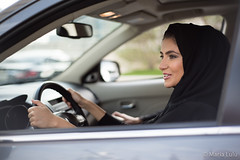 Middle Eastern Woman Driving a Car (ImagineWhat) Tags: woman smile dubai different looking gulf unique muslim traditional uae hijab culture move class east business upper middle eastern abaya forward confident qatar ethnicity garment emirati businesswoman