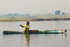 Fisherwoman (kissoflif3) Tags: morning portrait woman india lake net nature water lady fishing action indian catch fishingnet environmentalportrait fisherwoman makeshiftboat catchingfish jugaad bhigwanbirdsanctuary womanfishinginlake thermocolboat