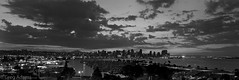 San Diego Skyline (Greg Adams Photography) Tags: california ca city sky urban blackandwhite bw panorama skyline clouds marina boats evening bay duck sandiego dusk gray calif southerncalifornia colorblind coronadobridge sandiegobay