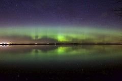 Horizons (John Andersen (JPAndersen images)) Tags: grass night clouds fence stars spring pond le alberta aurora