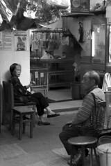 Sitting outside the chicken store (Job Homeless) Tags: blackandwhite hongkong streetphotography jordan f2 58mm helios44m monochorme streetsnap canon6d