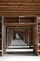 'Never Ending' (miranda.valenti12) Tags: door wood old shadow never building mill abandoned geometric architecture square outside outdoors hall doors factory box hallway aisle doorway walkway walls trippy passage pillars ending leadinglines