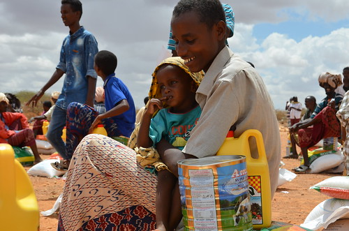 A drought-hit family in Puntland receive food aid