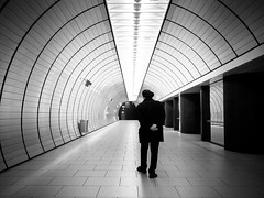subway walk (Sandy...J) Tags: street urban bw white man black station wall architecture germany underground walking subway munich mnchen bayern deutschland photography mono blackwhite alone fotografie walk wand streetphotography atmosphere olympus stadt ubahn architektur sw mann monochrom passage atmosphre bavarian gehen allein schwarzweis strasenfotografie