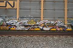 SECK (TheGraffitiHunters) Tags: auto street orange white black art car yellow train graffiti colorful paint purple tracks spray rack carrier freight autorack seck benched benching
