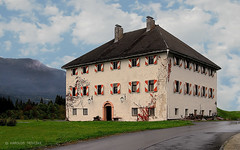 TRADITIONAL HOUSE IN KREUTH (AUSTRIA, CARINTHIA, KREUTH) (KAROLOS TRIVIZAS) Tags: road windows house building grass architecture austria lawn carinthia tradition chimneys kreuth
