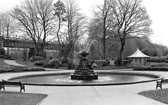 Miller Park Fountain Preston (Man with Red Eyes) Tags: slr film fountain monochrome analog blackwhite preston hp5 nikkor ilford millerpark listed nikonf6 f6 homedeveloped 50mmf12 silverhalide gradeii 73degrees filmisnotdead v850 td201 anchelltroop a3minsb3mins
