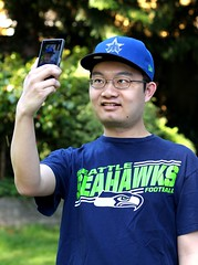 Selfie (PixelMakerEric) Tags: portrait people male guy smile fun outdoors happy student young cellphone lifestyle tshirt smartphone cap seahawks selfie