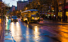 Street Blues (DobingDesign) Tags: sanfrancisco california road light people color reflection bus wet car reflections us twilight colours unitedstates outdoor dusk transport citylife streetphotography tram headlights vehicles powerlines citylights cablecar pedestrians bluehour tones aftertherain moist yellowandblue