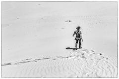 Cowboy without his horse (Chas56) Tags: blackandwhite sun hot canon walking landscape mono sand cowboy footprints dry australia monotone heat environment highkey arid rugged sanddunes victora wilsonspromontory canon5dmkiii