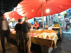 Red parasol of fruits stand (kawabek) Tags: thailand stall chiangmai 傘 タイ パラソル เชียงใหม่ ประเทศไทย チェンマイ 露店 ร่ม parsol แผง