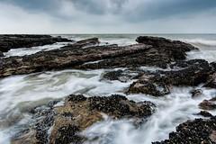 Frothy sea (James Waghorn) Tags: winter sea england beach water nikon rocks hastings eastsussex hoya pettlevel lr6 sigma1020f456 d7100 nd32