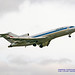 RISING 727 AGAINST THE OVERCAST PAINE FIELD SKY