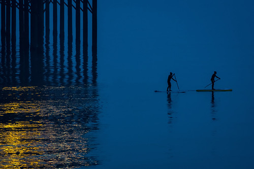 Paddleboarding UK-style ... in woolly hats