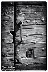 Wooden gate (Toucaly) Tags: door wood france detail metal outside gate europe fineart dordogne porte serrure noirblanc aspect aquitaine et saintcrpinetcarlucet elmentsarchitecturaux
