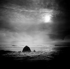 Raining in Black (Daniel Polidori) Tags: halinaprefect fujifilmneopanacros100 haystackrock cannonbeach oregoncoast pacificnorthwest analogue film toycamera bw blackandwhite bwfp boxcameras silhouette multipleexposure beach