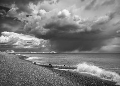 The Big Sky (Fourteenfoottiger) Tags: ocean light sea wild sky blackandwhite seascape storm beach monochrome weather clouds contrast sussex coast pier worthing seaside spring waves moody fuji seasons darkness angle cloudy wide dramatic wideangle stormy pebbles fourseasons coastline bigsky britishseaside wintery xt1 fujixt1