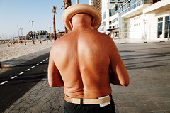 Untitled (nzkphotography) Tags: street travel sunset summer people beach hat israel telaviv 28mm middleeast streetphotography palmtrees ricohgr compact 2016 seriouscompacts