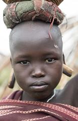 Portrait of a child from Mursi tribe with gauged piercings. (Matt Wicks / GreatDistances) Tags: africa portrait vertical children kid nikon child omovalley ethiopia nikkor50mmf18 piercings mursi omo eastafrica 2015 d610 southomo mursitribe gaugedpiercings