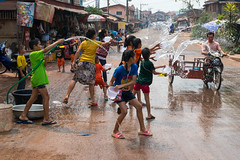 Pi Mai celebrations in central Lao PDR (Jeff Williams 03) Tags: water festival kids fun outside motorbike laos lao province pdr vientiane