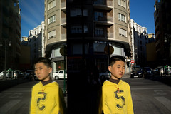 Kid number 5 (enmrd) Tags: street espaa color colour reflection valencia yellow calle kid spain sony streetphotography amarillo nio a7 amarilla valenciaspain mirrorless streetreflections fotografadecalle sonya7 sony35mmf28