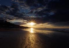 Sunburst (northsky) Tags: sunset sea england sun seascape color colour beach landscape evening pier sand waves yorkshire north sunburst saltburn