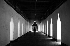 (cherco) Tags: light blackandwhite woman blancoynegro luz composition canon vanishingpoint alone arch gates perspective 5d myanmar lonely perspectiva arco puertas aloner