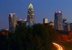 NH0A4968s (michael.soukup) Tags: sunset building tower skyline architecture skyscraper nc cityscape traffic charlotte outdoor dusk northcarolina citylights highrise bankofamerica bluehour lightstreak queencity lighttrail