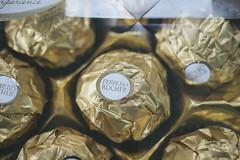 Ferrero Rocher (thisnoiseisnameless) Tags: food macro texture gold nikon chocolate gift ferrerorocher d3200 vsco filmemulation vscofilm
