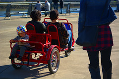 Three Wheeling (swong95765) Tags: park woman observation kid ride tricycle trike pedal
