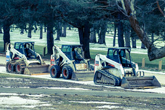 bobcat soldiers (Christian Collins) Tags: street winter tractor tracks machine soldiers bobcat bulldozer midland tryptych allinarow bucketloader