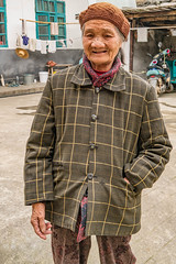 Lady in street.jpg (Photos4Health) Tags: china old travel sunset shadow woman guy ecology female sunrise dark person li asia village place guilin yangshuo hill chinese elderly fisher stick tradition guizhou villager guangxi ecotourism xingping
