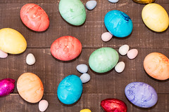 Colored Easter Eggs Layed Out On Board (Transient Eternal) Tags: pink blue orange holiday grass yellow easter spring candy background sugar celebration eggs sweets decorate decorated hardboiled holyweek gettogetherchildren