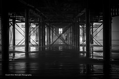Beneath the Pier (clive_metcalfe) Tags: woman pier sand pillar stay westonsupermare
