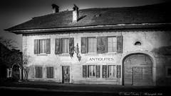Authentique antiquit (Pascal Dentan) Tags: switzerland photographie suisse noiretblanc reflet porte maison rue lampadaire inscription vaud luminaire antiquits oulens