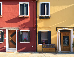 Mr. Burnt sienna next door to Mrs. Ochre (VillaRhapsody) Tags: venice houses windows winter italy colors facade buildings island happy colorful doors architcture colourful cheerful ochre venezia venedig burano burntsienna citytri