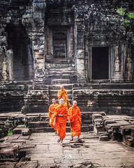 Buddhist monks at Cambodia (Color Odyssey) Tags: travel portrait people orange color heritage history architecture temple cambodia buddhist religion monk buddhism unesco siemreap travelphotography