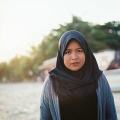 Qiqi (rifqi dahlgren) Tags: portrait woman film beach analog mediumformat indonesia muslim hijab balikpapan hasselblad500cm 80m kodakektar100