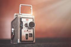 Kodak Brownie 8mm (ScottNorrisPhoto) Tags: camera film vintage lens photography shiny oldschool retro used explore chrome lensflare worn windup 8mm tabletop boxcamera photocomposite warmtones kodakbrownie stilllifephotography 365project kodachromefilm scottnorrisphotography