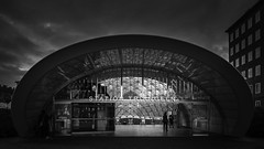Station Triangeln Southern Entrance (Mabry Campbell) Tags: people blackandwhite bw lines station sign architecture dark photography photo skne europe december moody arch photographer exterior image fav50 sweden escalator fav20 photograph trainstation 400 dome 24mm exit escalators scandinavia fav30 geodesic malm malmo 2012 fineartphotography f63 tiltshift architecturalphotography skane triangeln commercialphotography fav10 fav100 fav40 fav60 architecturephotography fav90 fav80 fav70 tse24mmf35l fineartphotographer houstonphotographer sec mabrycampbell december222012 201212221324 triangelnstationn