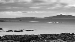 Take me to the distant past (OR_U) Tags: uk longexposure sea sky blackandwhite bw white mountain seascape black water wales port landscape grey coast blackwhite widescreen le oru schwarzweiss 169 distant anglesey holyhead 2016 everythingeverything