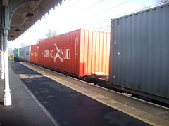 A section of the Container Train bound for Crewe Basford Hall passing through Needham Market Station. (DesiroDan) Tags: containertrain greateasternmainline containerwagons needhammarketstation ukcontainertrains freighttrainsineastanglia